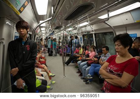 SINGAPORE - CIRCA FEBRUARY, 2015: Passengers in the train MRT. Singapore subway, also known as MRT, started operating in 1987. It is network length is 130 kms, it has 87 stations and 4 lines.
