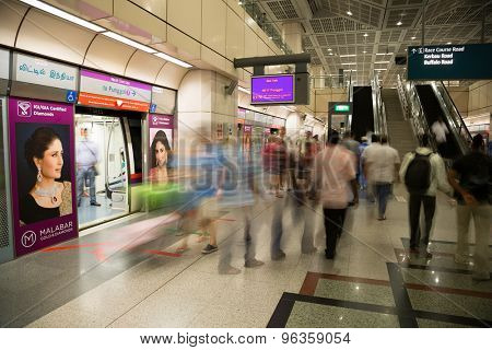 SINGAPORE - CIRCA FEBRUARY, 2015: Passengers at the MRT station in Singapore. MRT is a rapid transit system forming the major component of the railway system in Singapore.