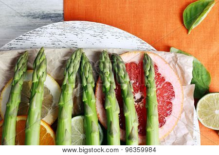 Fresh asparagus on wooden tray, close-up