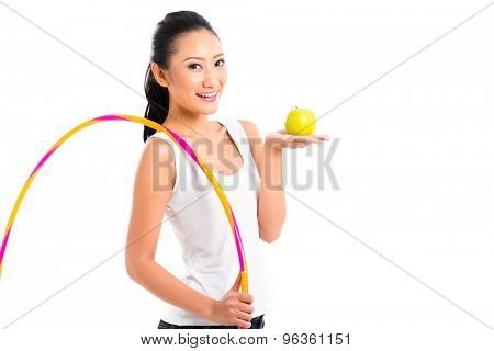 Young Asian woman living healthy and eating fruits