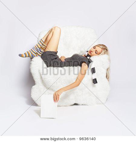 Girl Sleeping In Arm-chair