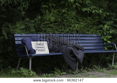 Homeless man on bench