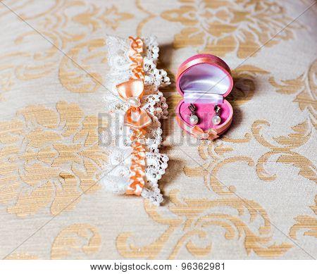 wedding garter and earrings