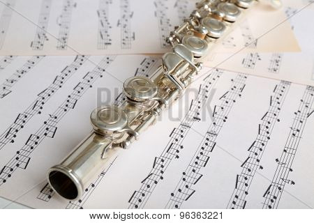 Flute on music notes background