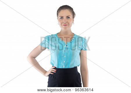Woman in blue blouse with hand on hip