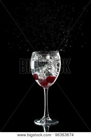 Three Cherries In A Glass Drops Splashing