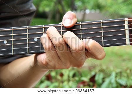 playing guitar chord F#