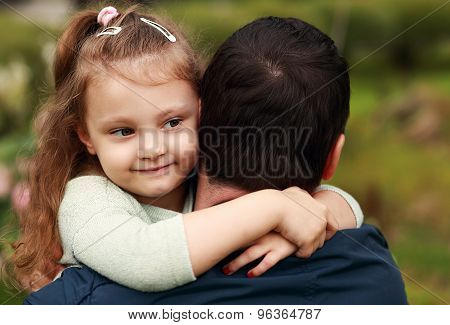 Happy Pretty Smiling Kid Girl Hugging Her Father With Love Outdoor