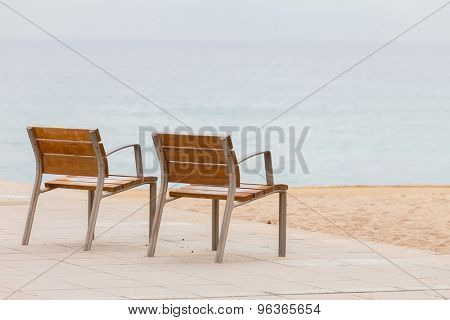 empty chairs on the beach