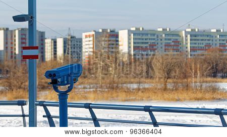 A Coin Operated Binocular For Viewing A City