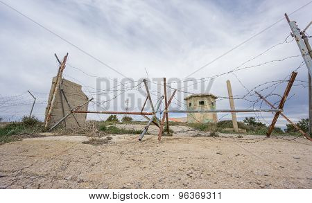 Abandoned military zone with rusty spiked fence