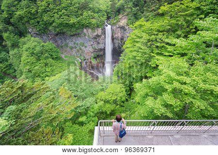 Blurred tourist visiting Kegon Falls, Nikko, wide angle