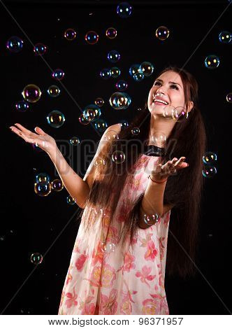 Beautiful Young Woman With Soap Bubbles