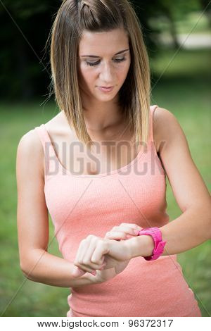 Healthy sport woman using smart watch to track fitness activity
