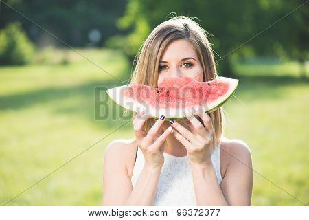 Beautiful girl eating fresh watermelon