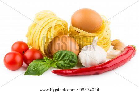 Pasta Tagliatelle, Tomatoes, Garlic, Chili Pepper And Basil Leaves