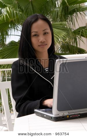 Asian Business Woman At Laptop