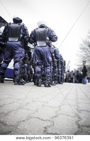 Unit of police special forces in riot gear waiting for orders.