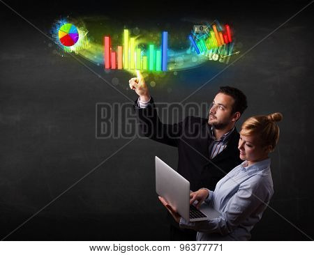 Business couple touching colorful modern graph system concept