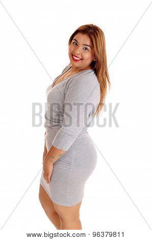 Woman In Gray Dress In Profile.