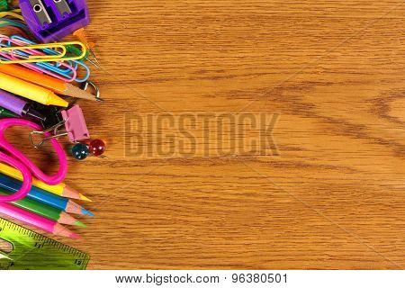 School supplies side border on wood desk