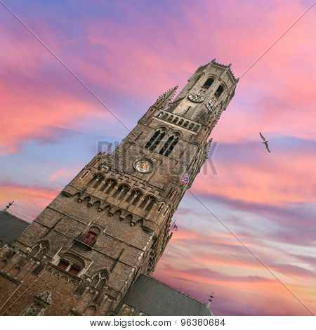 Belfry bell tower on sunset in Bruges, Belgium