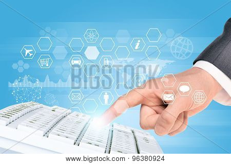Businessmans hand with keyboard and icons