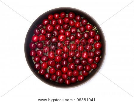 Top view of red cherry in round baking tin, isolated on white background