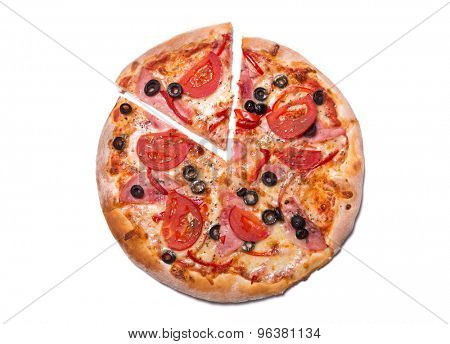 Top view of delicious pizza with ham and tomatoes with a slice removed, isolated on white background