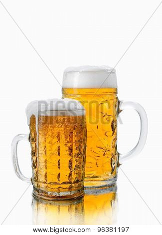 Two Different Glasses Of Beer