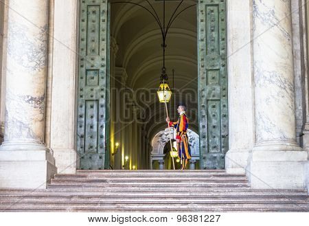Swiss guard in a Vatican building entrance