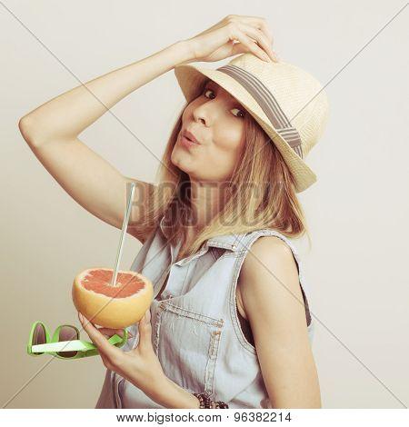 Woman In Hat Drinking Grapefruit Juice. Diet