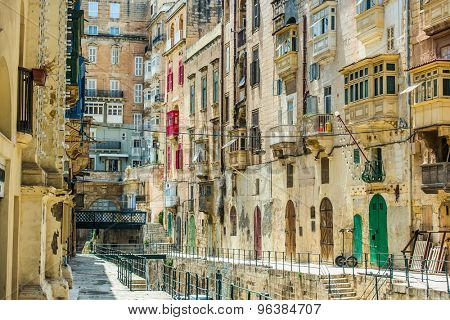 street with colorful vintage gates and balconies in Valletta historical center in Malta