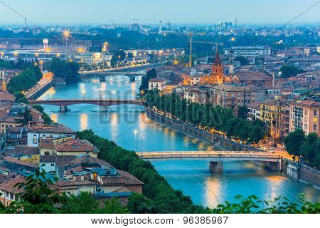 River Adige and bridges in Verona at night, Italy