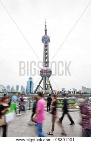 Commuters walking on a walkway at the Bund, Shanghai