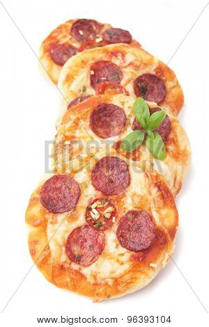 Mini salami or pepperoni pizza isolated on white background