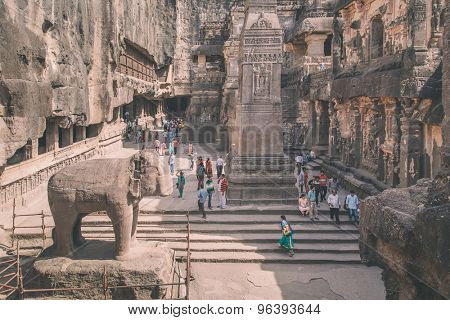 ELLORA, INDIA - 14 JANUARY 2015: North side of Kailasa temple part of Ellora Caves. One of biggest rock-cut ancient Hindu temples. Processed with grain, texture and color effect.