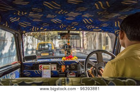 MUMBAI, INDIA - 17 JANUARY 2015: Old taxi's upholstery in Mumbai are decorated Indian style.