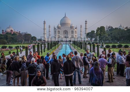 AGRA, INDIA - 28 FEBRUARY 2015: View of Taj Mahal in front of the Great Gate. South side with many tourists.