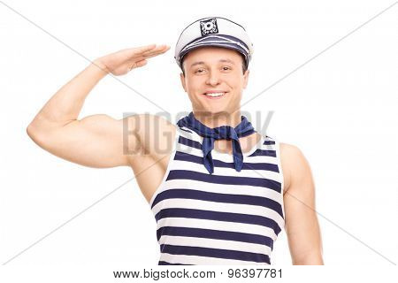 Young male sailor standing straight and saluting towards the camera isolated on white background