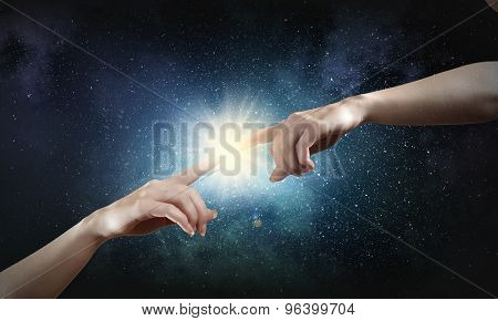 Close up of human hands reaching each other with fingers