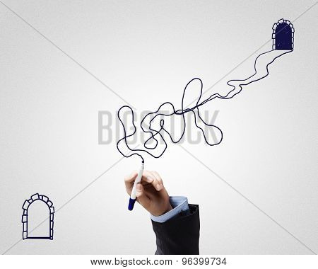 Close up of male hand drawing twisted way from one door to another