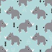 foto of rhino  - Seamless blue kids geometric triangle and rhino animals illustration background pattern in vector - JPG