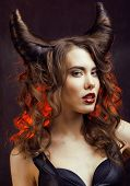 image of evil queen  - bright mysterious woman with horn hair - JPG