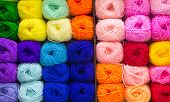 image of knitting  - Many Colorful knitting wools arrange in row - JPG