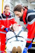 picture of accident emergency  - Emergency doctor and nurse or ambulance team transporting accident victim on stretcher - JPG