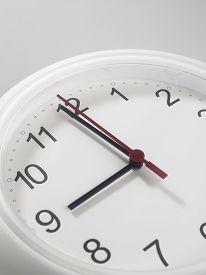 foto of analog clock  - Close up of an analog clock at 9 o - JPG