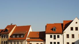 stock photo of red roof  - Roofs of an old town - JPG