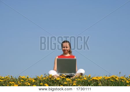 Casual Young Woman With Laptop Outdoors