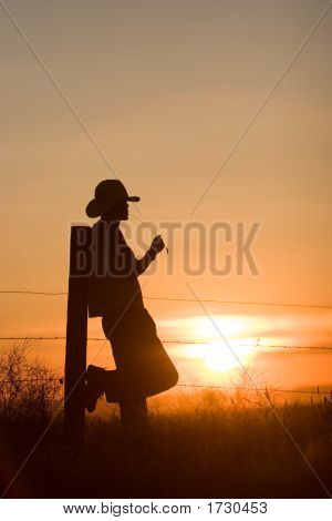 Cowboy Watching Sunset